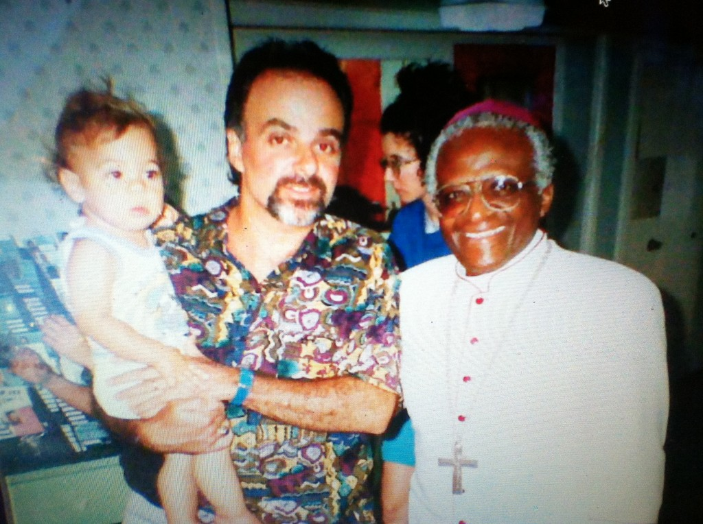 Michael Scarpaci as an infant with Desmond Tutu