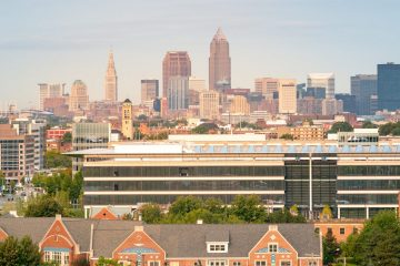 Photo looking out at the Samson Pavilion with the Cleveland skyline in the background