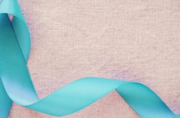 Photo of a teal ribbon for sexual assault awareness