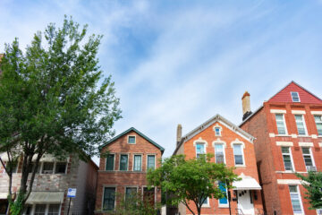 A row of old brick homes in the Pilsen neighborhood of Chicago during the summer