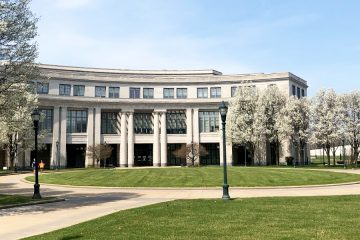 Photo of Kelvin Smith Library surrounded by spring trees