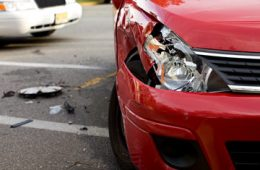 Close up photo showing damage to the headlight of a car during a crash