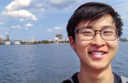Selfie photo of Daniel Shao in front of a body of water