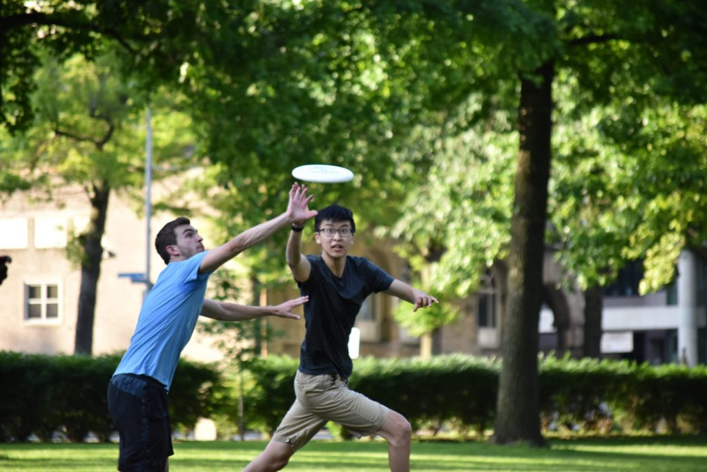 Photo of Daniel Shao and a friend both vying to catch a frisbee
