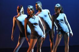 Photo of four dancers in a production of Imagatorium