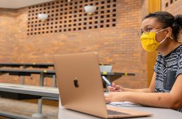 Photo of a masked student in class