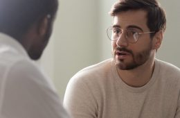 Photo of a man talking to a doctor