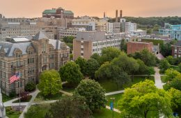Photo looking down on the Case Quad with an orange-hued sky