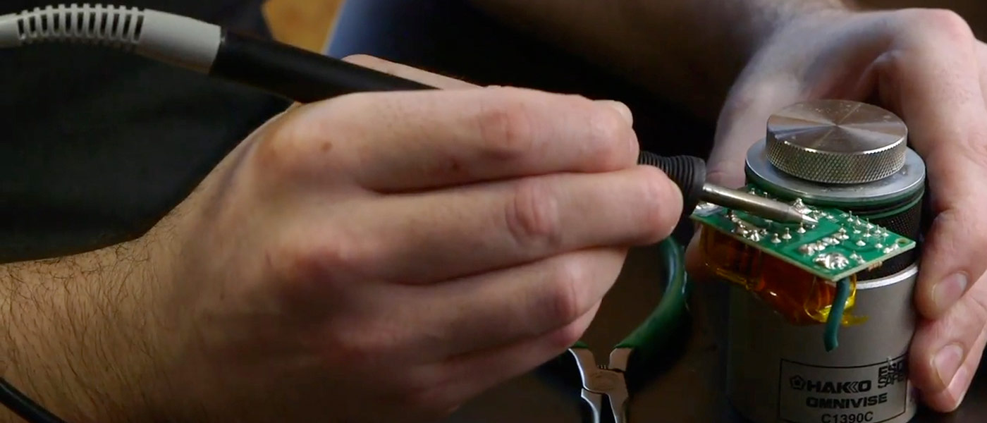 Close up photo showing someone working on a mechanical device