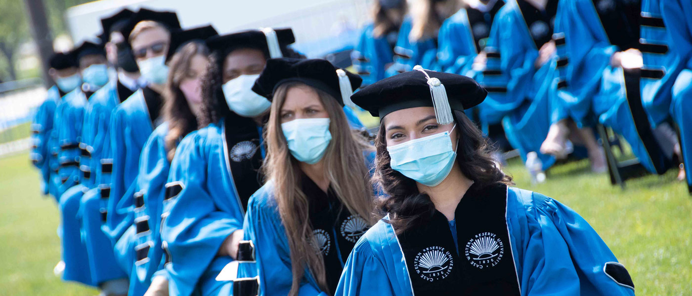 Photo of School of Medicine graduates seated in a line