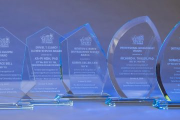 Photo of alumni association award plaques lined up