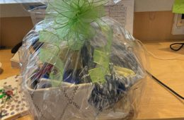 Photo of a gift basket wrapped in clear plastic