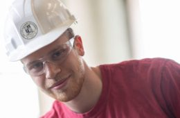 Photo of Luke Traverso wearing a hard hat and safety glasses
