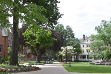 Photo of the Mather Quad looking down a pathway leading toward buildings
