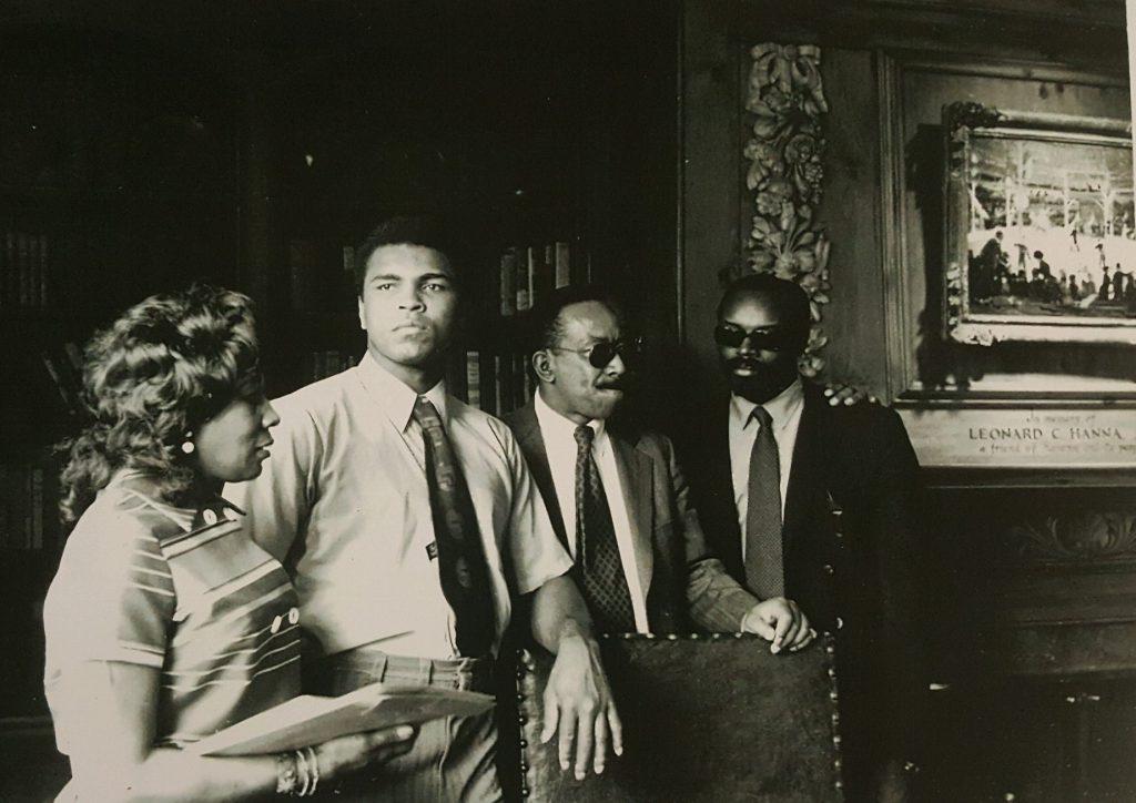 Black and white photo of Muhammad Ali in the Hanna Lounge at Karamu House