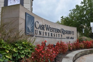 Photo of the CWRU sign on the corner of Euclid Avenue and Adelbert Road
