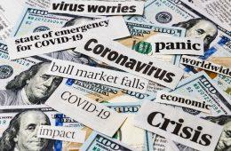 Coronavirus, covid-19 news headlines on United States of America 100 dollar bills. Concept of financial impact, stock market decline and crash due to worldwide pandemic