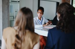 A female therapist gives advice to a female client during a therapy session