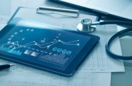 Healthcare business concept, Medical examination and growth graph data of business on tablet with doctor's health report clipboard on background.