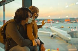 Father and son traveling by plane
