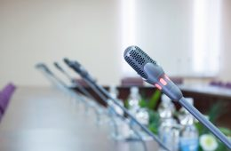 close up of a microphone in empty conference hall