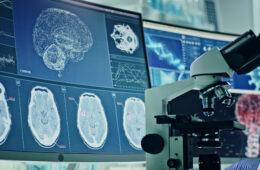 Computer screens in laboratory. Brain scans and coronavirus research