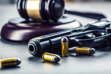 Judge's hammer gavel. Justice and gun