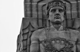 Black and white photo showing the top of one of the Guardians of Traffic sculptures