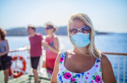 Woman on cruise ship with protective face mask