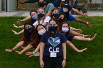 Photo of CWRU orientation leaders standing in a line with their arms out