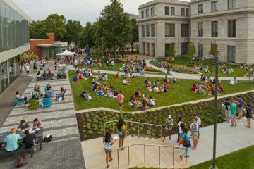 Photo of students gathering on Frieberger Field outside of Tinkham Veale University Center