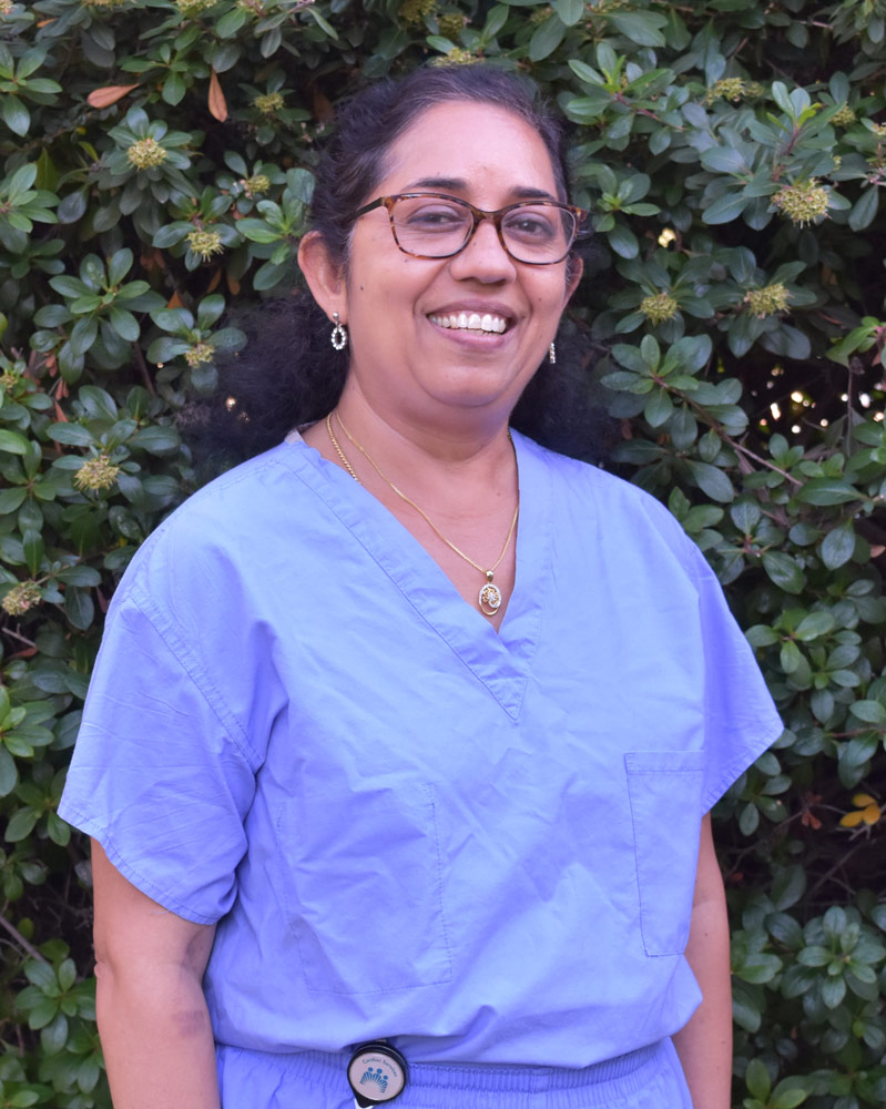 Photo of Uma Vadlakonda in scrubs