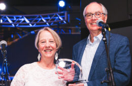 Photo of Jan and David Abbott holding an award
