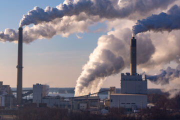 Photo of wind blowing pollution from a coal power plant