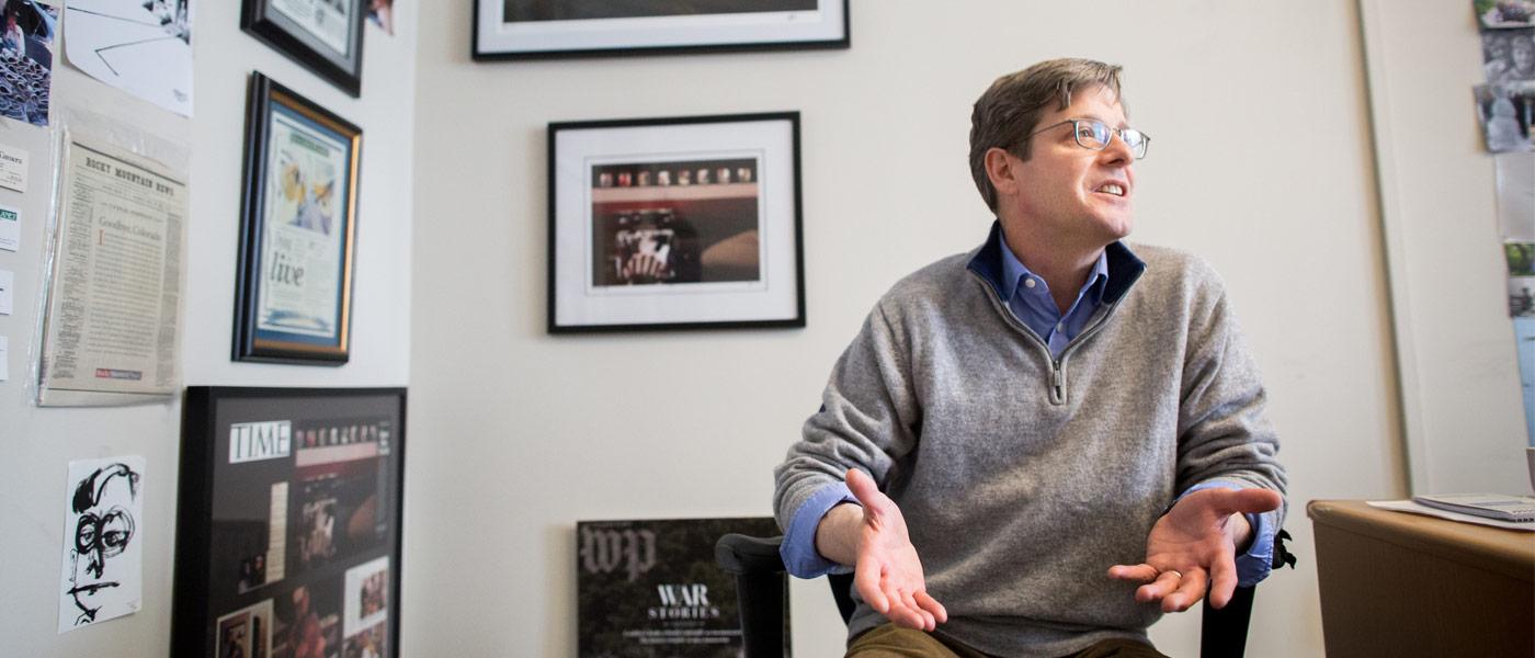Photo of Jim Sheeler talking in his office