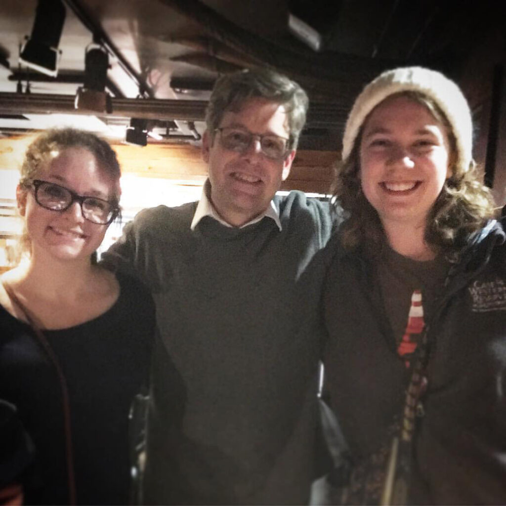 Jim Sheeler poses for a photo with Anne Nickoloff and Julia Bianco