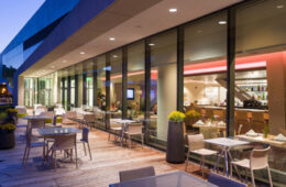 Photo of the patio of the Michelson and Morely restaurant at night