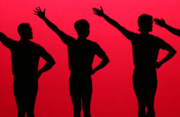 silhouette of five dancers with one hand on their hip and the other outstretched, all against a red background