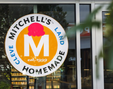 Photo of the Mitchell's Ice Cream sign in the window of its Uptown location