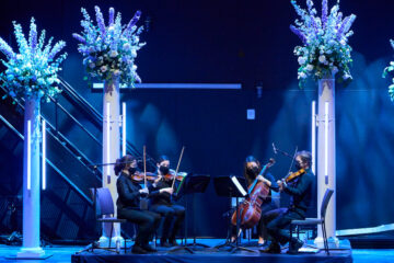 Photo of student musicians performing on stage at the Maltz Performing Arts Center