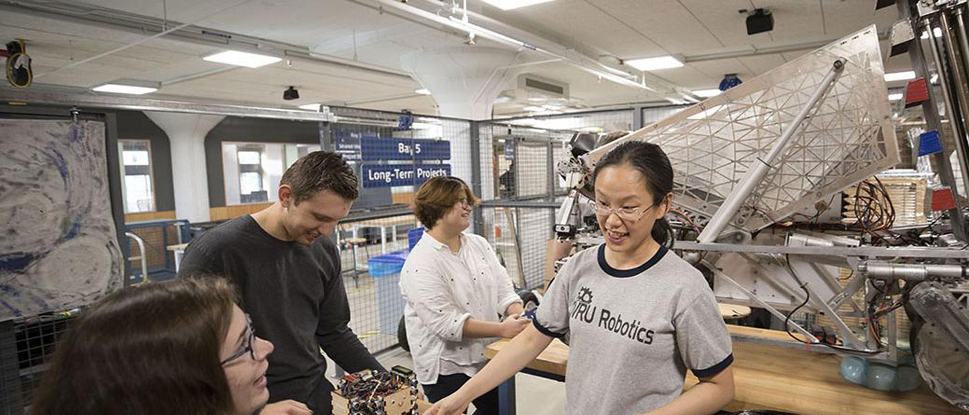 Photo of CWRU students working on a robotics project at Sears think[box]